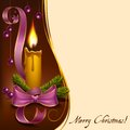 Christmas lighted candle with beads decorated fir branches ribbons and to format Stock Photo