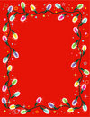 Christmas lights border or frame on red Royalty Free Stock Photo