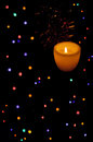Christmas lights and candle Stock Image