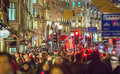 Christmas lights decoration at Regent street and lots of people. London Royalty Free Stock Photo