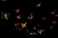 Christmas lights fly as butterflies in the night creative Royalty Free Stock Photo