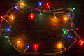 Christmas lights garland on wooden background Stock Photos