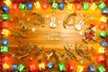 Christmas lights gift box frame and musical instrument on golden Royalty Free Stock Photo