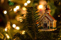 Christmas lights glimmering with ornament glowing in background church in front Royalty Free Stock Photography