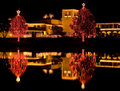 Christmas Lights Reflected In Lake Stock Photo