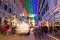 Christmas lights in roma december and people on via del corso italy Royalty Free Stock Image