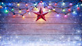 Christmas Lights And Star Hanging Royalty Free Stock Photo