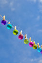 Christmas on line christmas baubles small hanging a clothesline Stock Images