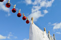 Christmas on line christmas baubles small hanging a clothesline Royalty Free Stock Photo