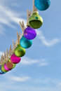 Christmas on line christmas baubles small hanging a clothesline Stock Photo