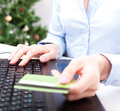 Christmas on line shopping woman using credit card for payment new year tree background Royalty Free Stock Photos