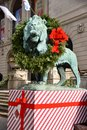 Christmas lion this is a holiday picture of one of the art institute lions with his holliday wreath located in chicago illinois Stock Photos