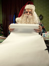 Christmas list santa claus checking his Stock Photo