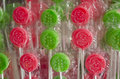 Christmas lollipops strips of cellophane wrapped with santa faces and trees in seasonal colors of red and green Stock Images