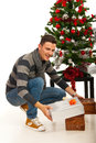 Christmas man arrange presents under tree Royalty Free Stock Photos