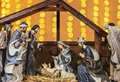 Christmas nativity scene with figurines in lights Royalty Free Stock Photo