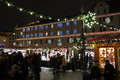 Christmas market in city center lighted by night Royalty Free Stock Photo