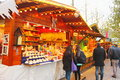 Christmas market shopping in the checking the stands Royalty Free Stock Images