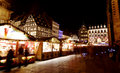 Christmas market in strasbourg at night with illuminated stalls foreground france Royalty Free Stock Photography