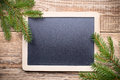Christmas menu blackboard and wooden background Royalty Free Stock Images