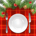Christmas menu template with holiday decorations and tartan tablecloth Royalty Free Stock Image