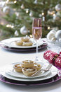 Christmas mince pies cracker and champagne flute on dining table Royalty Free Stock Photos