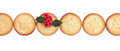 Christmas mince pies pie cakes in a line with holly over white background Royalty Free Stock Image