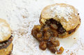 Christmas mince pies traditional handmade pie sprinkled with icing sugar and spices sultanas and raising filling spilling on the Royalty Free Stock Photography