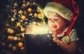 Christmas miracle, magic gift box and child baby girl Royalty Free Stock Photo