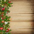 Christmas miraculous garland on a wooden background pine branch with decorations Stock Photography