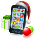 Christmas mobile phone illustration a cell with a santa hat and baubles and gift with ribbon bow Stock Image