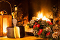 Christmas mood food from italy typical seasoned cheese from pienza in front of country fireplace Royalty Free Stock Photography
