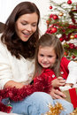 Christmas:Mother with child opening present Royalty Free Stock Photos