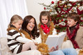 Christmas: mother with three children Stock Photos