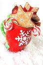Christmas mug and cookies filled with gingerbread candy Stock Photography