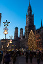 Christmas in munich marienplatz and the neues rathaus new city hall fully decked out of lights for Stock Photo