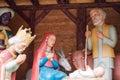 Christmas nativity scene with baby Jesus, Mary and Joseph in barn. Royalty Free Stock Photo