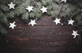 Christmas or New Year background: fur-tree branches, decoration and glittering stars on wood, top view, copy space Royalty Free Stock Photo
