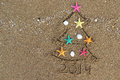 Christmas and new year on the beach pf Stock Image