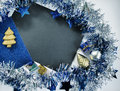 Christmas or New Year composition on white. Blue sparkling ribbon wreath. Royalty Free Stock Photo