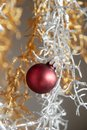 Christmas – New Year decoration abstract background with silver and golden branch and red glass ball Royalty Free Stock Photo