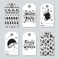 Christmas and New Year gift tags. Cards xmas set with hand drawing elements. Collection of holiday paper label in black