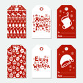 Christmas and New Year gift tags. Cards xmas set with hand drawing elements. Collection of holiday paper label in red