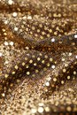 Christmas New Year Gold Glitter background. Holiday abstract texture fabric