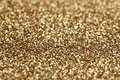 Christmas New Year Gold and Silver Glitter background. Holiday abstract texture Royalty Free Stock Photo