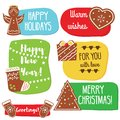 Christmas and New Year greeting tags with gingerbread cookies. Traditional seasonal warm wishes