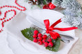 Christmas And New Year Holiday Table Setting. Celebration. Place setting for Christmas Dinner. Holiday Decorations. Decor. Royalty Free Stock Photo