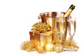 Christmas or New Year's Eve. Champagne and Gold Presents Royalty Free Stock Photo