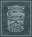 Christmas new year vintage label and frame on a blackboard Royalty Free Stock Photo