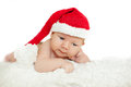 Christmas newborn baby in santa hat. Winter child on winter whit